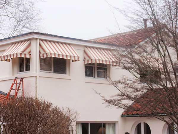 three striped fixed frame awnings