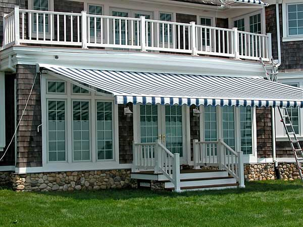 Blue and White Retractable Awning