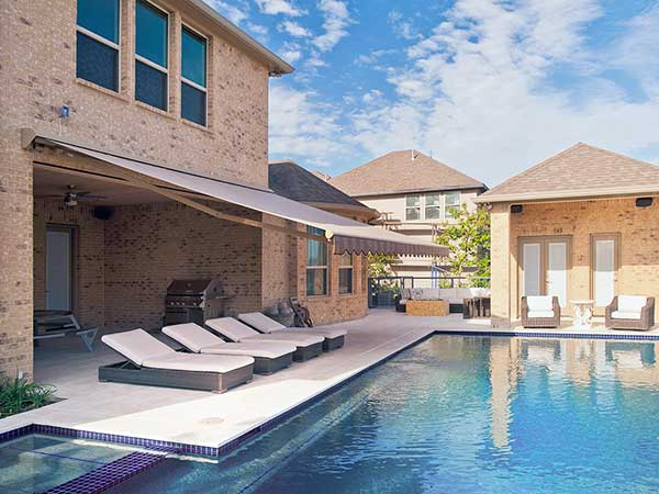 Retractable Awnings by a pool