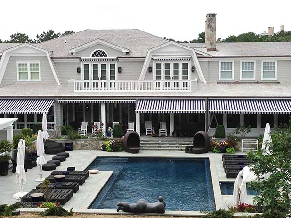 Striped Retractable Awnings by a pool