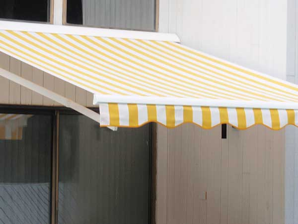 Yellow striped Retractable Awning